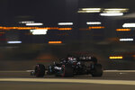 Mercedes driver Lewis Hamilton of Britain steers his car during the qualifying session at the Formula One Bahrain International Circuit in Sakhir, Bahrain, Saturday, Nov. 28, 2020. (Brynn Lennon, Pool via AP)