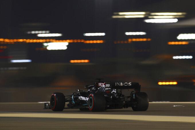 Mercedes driver Lewis Hamilton of Britain steers his car during the qualifying session at the Formula One Bahrain International Circuit in Sakhir, Bahrain, Saturday, Nov. 28, 2020. (Brynn Lennon, Pool via AP)