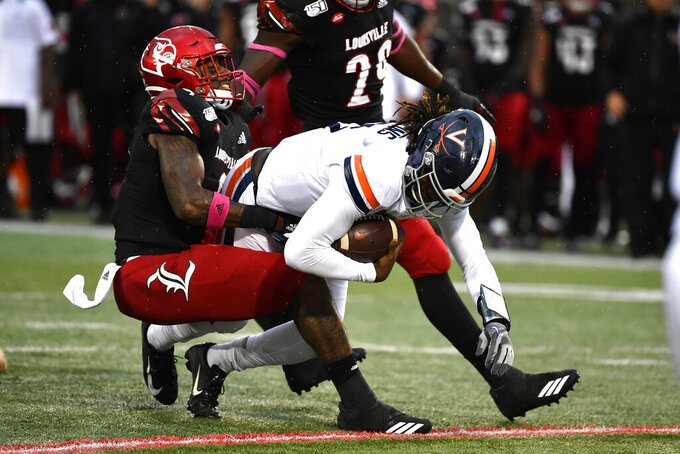 Virginia quarterback Bryce Perkins (3) is brought down by Louisville linebacker C.J. Avery (9) during the first half of an NCAA college football game in Louisville, Ky., Saturday, Oct. 26, 2019. (AP Photo/Timothy D. Easley)