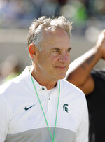 Michigan State coach Mark Dantonio  walks across the field before an NCAA college football game against Arizona State, Saturday, Sept. 14, 2019, in East Lansing, Mich. (AP Photo/Al Goldis)