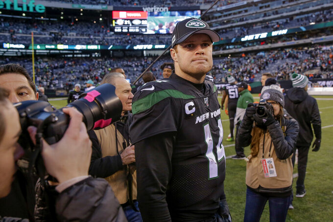 New York Jets quarterback Sam Darnold (14) walks off the field after the Jets beat the Miami Dolphins 22-21 in an NFL football game, Sunday, Dec. 8, 2019, in East Rutherford, N.J. (AP Photo/Seth Wenig)