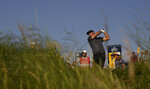 United States' Brooks Koepka play his shot from the 3rd tee during the first round British Open Golf Championship at Royal St George's golf course Sandwich, England, Thursday, July 15, 2021. (AP Photo/Alastair Grant)