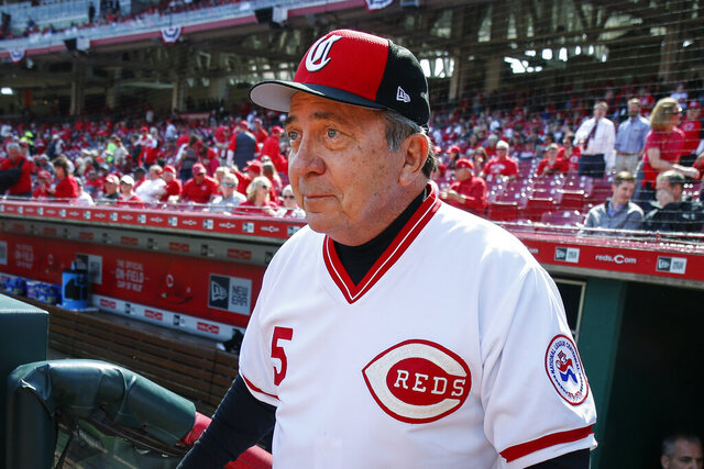 FILE - In this March 28, 2019, file photo, former Cincinnati Reds catcher Johnny Bench walks up to the field before the team's opening-day baseball game against the Pittsburgh Pirates in Cincinnati. Personal memorabilia from Bench's career was auctioned for just under $2 million. The sale that involved live and online bidding ended Saturday, Nov. 14, 2020, at the Louisville Slugger Museum and Factory in Kentucky, not far from where Bench was a 14-time All-Star for the during his 17-year major league career. (AP Photo/Gary Landers, File)