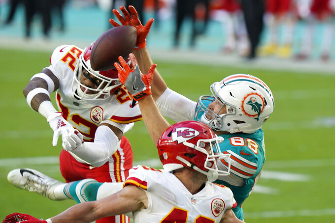 Miami Dolphins tight end Mike Gesicki (88) catches a touchdown pass, during the second half of an NFL football game against the Kansas City Chiefs, Sunday, Dec. 13, 2020, in Miami Gardens, Fla. (AP Photo/Wilfredo Lee)