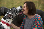 "Lindsay Terwilliger gets kisses from her great Dane, Theia, at her farm in Elon, Va. on Thursday, Dec. 17, 2020. Terwilliger, who has been fostering and rescuing animals for 15 years, said animals have a tendency to ""choose"" their owners, which she believes all of her animals have done with her. (Kendall Warner/The News & Advance via AP)"