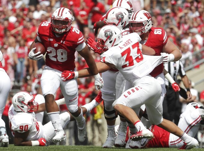 Wisconsin's Taiwan Deal runs during the second half of an NCAA college football game against New Mexico Saturday, Sept. 8, 2018, in Madison, Wis. Wisconsin won 45-14. (AP Photo/Morry Gash)
