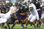 Michigan State linebacker Joe Bachie (35) and defensive tackle Mike Panasiuk (72) sack Northwestern quarterback Hunter Johnson (15) during the first half of an NCAA college football game, Saturday, Sept. 21, 2019, in Evanston, Ill. (AP Photo/David Banks)