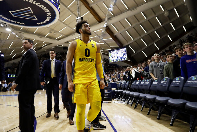 Marquette's Markus Howard walks off the court after the team's NCAA college basketball game against Villanova, Wednesday, Feb. 27, 2019, in Villanova, Pa. Villanova won 67-61. (AP Photo/Matt Slocum)