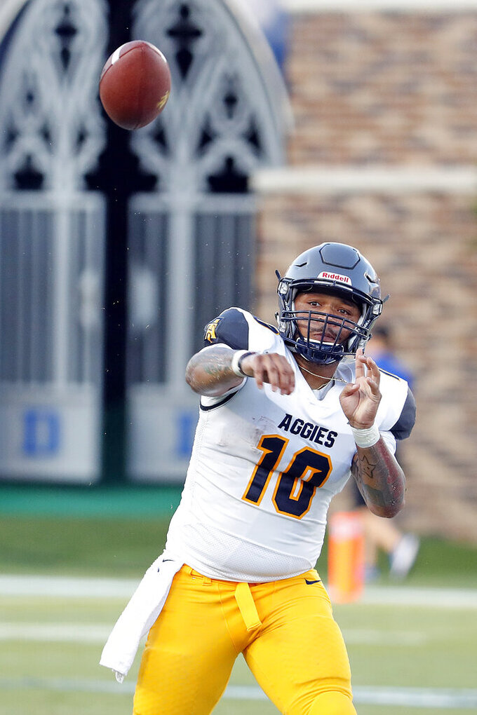 North Carolina A&T's Kylil Carter (10) passes the ball during the first half of an NCAA college football game against the Duke in Durham, N.C., Saturday, Sept. 7, 2019. (AP Photo/Karl B DeBlaker)