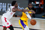 Los Angeles Lakers' LeBron James passes around Toronto Raptors' OG Anunoby (3) during the second half of an NBA basketball game Saturday, Aug. 1, 2020, in Lake Buena Vista, Fla. (AP Photo/Ashley Landis, Pool)