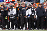 Cincinnati Bengals head coach Zac Taylor, center, reacts to a play call resulting in a New England Patriots fumble recovery off wide receiver Alex Erickson in the first half of an NFL football game, Sunday, Dec. 15, 2019, in Cincinnati. (AP Photo/Gary Landers)