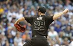 Arizona Diamondbacks starting pitcher Merrill Kelly throws during the first inning of a baseball game Milwaukee Brewers Friday, Aug. 23, 2019, in Milwaukee. (AP Photo/Morry Gash)
