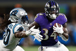 Baltimore Ravens running back Ty'Son Williams is tackled by Carolina Panthers linebacker Julian Stanford during the first half of a preseason NFL football game Saturday, Aug. 21, 2021, in Charlotte, N.C. (AP Photo/Nell Redmond)