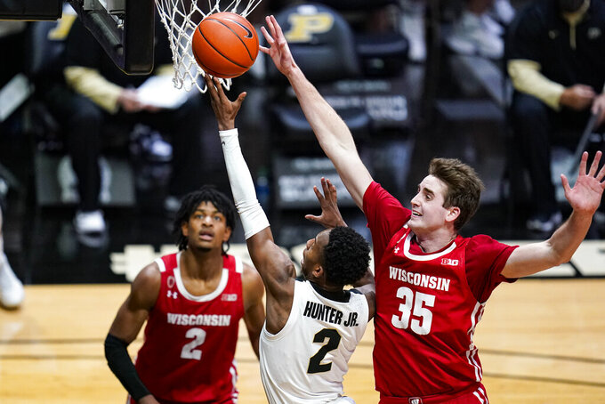 Wisconsin forward Nate Reuvers (35) comes from behind to block the shot of Purdue guard Eric Hunter Jr. (2) during the second half of an NCAA college basketball game in West Lafayette, Ind., Tuesday, March 2, 2021. (AP Photo/Michael Conroy)