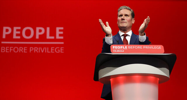 FILE- In this Monday, Sept. 23, 2019 file photo, Britain's Shadow Brexit Secretary Keir Starmer speaks on stage during the Labour Party Conference at the Brighton Centre in Brighton, England. Britain's main opposition Labour Party has elected lawyer and lawmaker Keir Starmer as its new leader, after a contest thrown into turmoil by the coronavirus outbreak, it was announced on Saturday, April 4, 2020. (AP Photo/Kirsty Wigglesworth, file)
