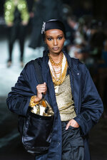 A model walks the runway at the Tom Ford spring/summer 2022 fashion show in the Lincoln Center during New York Fashion Week on Sunday, Sept. 12, 2021. (AP Photo/Eduardo Munoz Alvarez)