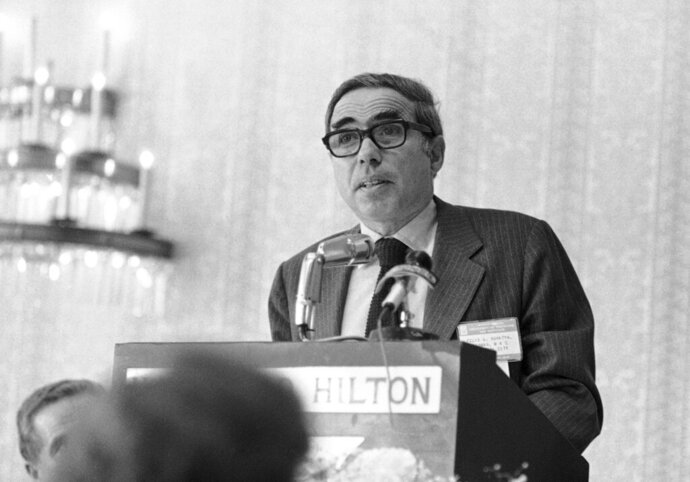 FILE - In this Nov. 12, 1976, file photo, Felix Rohatyn, head of New York's Municipal Assistance Corp. (MAC) speaks at a meeting of the University of Hartford's tax institute in Hartford, Conn. A banker who was credited with saving New York City from financial ruin, Rohatyn died Saturday, Dec. 14, 2019, at his home in Manhattan. He was 91. (AP Photo, File)