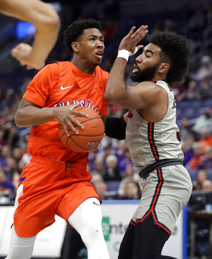 Evansville's Marty Hill, left, heads to the basket past Illinois State's Keyshawn Evans during the first half of an NCAA college basketball game in the first round of the Missouri Valley Conference men's tournament Thursday, March 7, 2019, in St. Louis. (AP Photo/Jeff Roberson)
