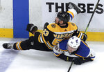 Boston Bruins' Brad Marchand, left, checks St. Louis Blues' Vladimir Tarasenko, of Russia, to the ice during the third period in Game 5 of the NHL hockey Stanley Cup Final, Thursday, June 6, 2019, in Boston. (AP Photo/Charles Krupa)