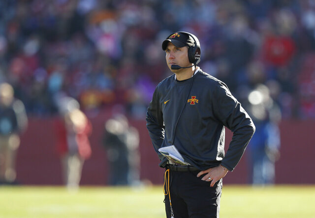 Iowa State head coach Matt Campbell looks to the scoreboard after Kansas scored a touchdown during the second half of an NCAA college football game, Saturday, Nov. 23, 2019, in Ames, Iowa. Iowa State won 41-31. (AP Photo/Matthew Putney)