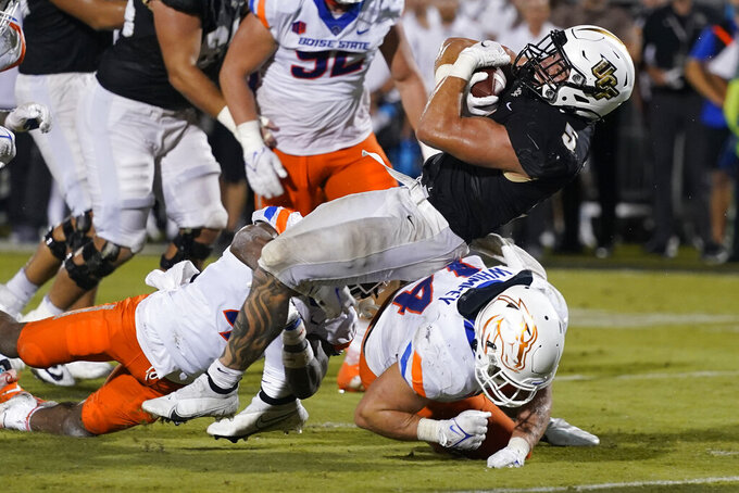 Central Florida running back Isaiah Bowser, right, scores on an 8-yard run, over Boise State linebacker Riley Whimpey during the second half of an NCAA college football game early Friday, Sept. 3, 2021, in Orlando, Fla. (AP Photo/John Raoux)