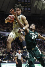 Purdue guard Carsen Edwards (3) grabs a rebound over Michigan State forward Xavier Tillman (23) during the first half of an NCAA college basketball game in West Lafayette, Ind., Sunday, Jan. 27, 2019. (AP Photo/Michael Conroy)