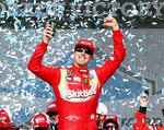 Kyle Busch celebrates in Victory Lane after winning the NASCAR Cup Series auto race at ISM Raceway, Sunday, March 10, 2019, in Avondale, Ariz. (AP Photo/Ralph Freso)