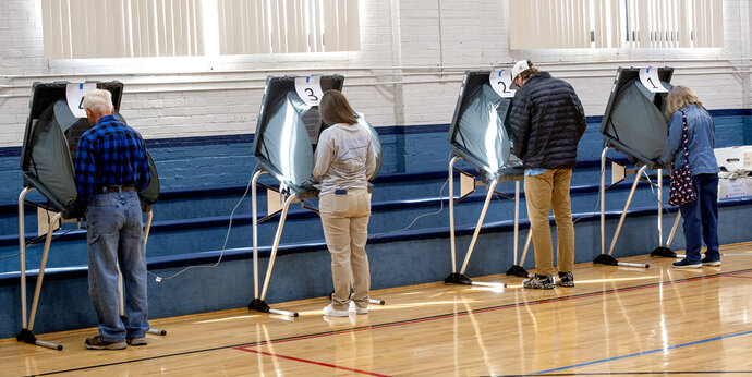 Voters cast their votes at the Slater Center in Bristol, Tenn. on Tuesday, Nov. 3, 2020. Election day lines were short in most locations due to the large number of voters that took advantage of the early voting. (David Crigger/Bristol Herald Courier via AP)