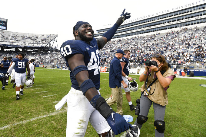Penn State linebacker Jesse Luketa (40) celebrates a 38-17 victory over Villanova during an NCAA college football game in State College, Pa., on Saturday, Sept.25, 2021. (AP Photo/Barry Reeger)