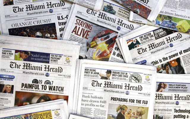 FILE - IN this Oct. 14, 2009 file photo, copies of the McClatchy Co. owned Miami Herald newspaper are shown in Miami.  The publisher of the Miami Herald, The Kansas City Star and dozens of other newspapers across the country has filed for bankruptcy protection, Thursday, Feb. 13, 2020. McClatchy Co.'s 30 newsrooms will continue to operate as usual as the publisher reorganizes under Chapter 11 bankruptcy protection.   (AP Photo/Wilfredo Lee, File)