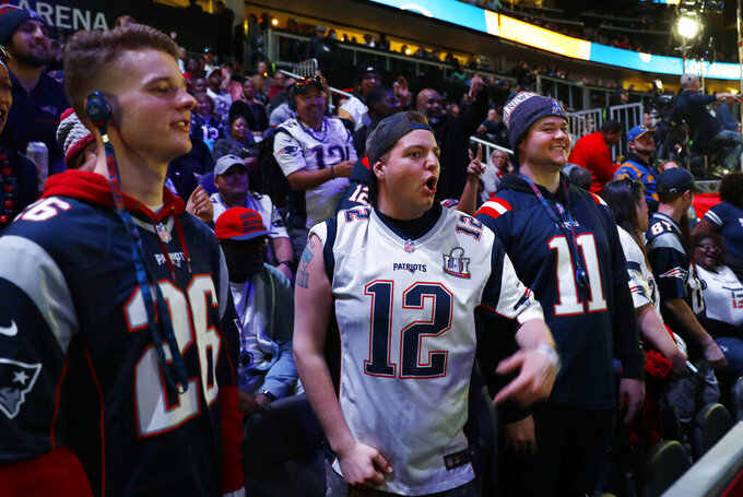 Fans yell during Opening Night for the NFL Super Bowl 53 football game Monday, Jan. 28, 2019, in Atlanta. (AP Photo/David Goldman)