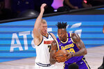 Los Angeles Lakers' Dwight Howard (39) drives against Denver Nuggets' Mason Plumlee (7) during the first half of an NBA conference final playoff basketball game Saturday, Sept. 26, 2020, in Lake Buena Vista, Fla. (AP Photo/Mark J. Terrill)
