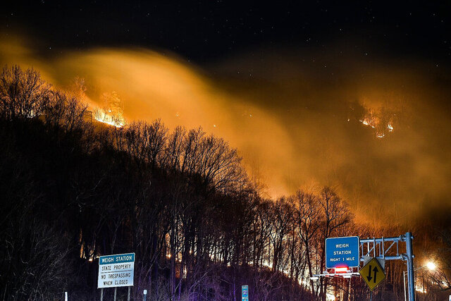 ADDS DATE - This photo provided by Adam Polinger shows a wildfire near the New Jersey side of the Delaware Water Gap National Recreation Area near Hardwick Township, N.J., Sunday, Feb. 23, 2020. Firefighters from federal and New Jersey agencies were battling the forest fire that broke out in a popular hiking area near the Pennsylvania border. (Adam Polinger via AP)