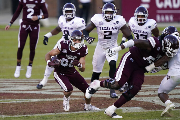 Mississippi State wide receiver Austin Williams (85) follows a block by offensive lineman Greg Eiland (55) as he heads upfield with a first down pass reception during the second half of an NCAA college football game in Starkville, Miss., Saturday, Oct. 17, 2020.  (AP Photo/Rogelio V. Solis)