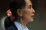 Myanmar's leader Aung San Suu Kyi addresses judges of the International Court of Justice for the second day of three days of hearings in The Hague, Netherlands, Wednesday, Dec. 11, 2019. Aung San Suu Kyi will represent Myanmar in a case filed by Gambia at the ICJ, the United Nations' highest court, accusing Myanmar of genocide in its campaign against the Rohingya Muslim minority. (AP Photo/Peter Dejong)