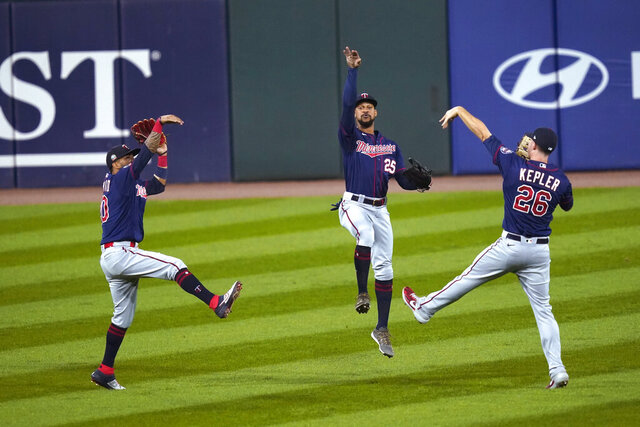 Minnesota Twins outfielders Eddie Rosario, Byron Buxton and Max Kepler, from left, celebrate the team's 5-1 win over the Chicago White Sox in a baseball game Wednesday, Sept. 16, 2020, in Chicago. (AP Photo/Charles Rex Arbogast)