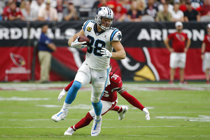 Carolina Panthers tight end Greg Olsen (88) runs as Arizona Cardinals free safety D.J. Swearinger (36) pursues during the second half of an NFL football game, Sunday, Sept. 22, 2019, in Glendale, Ariz. (AP Photo/Rick Scuteri)