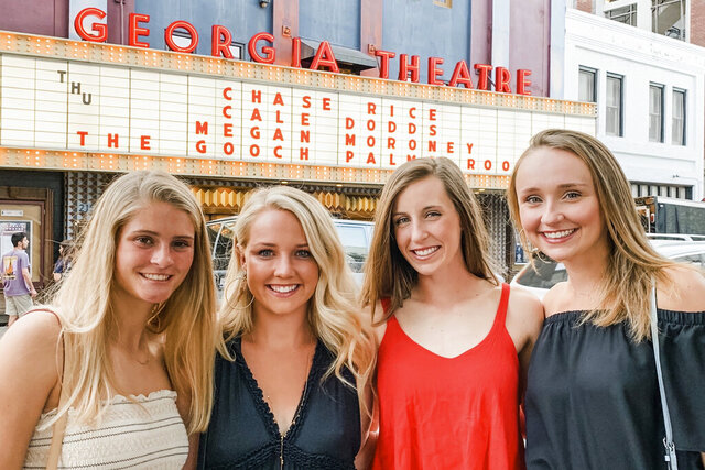** HOLD FOR STORY ** In this April 11, 2019, photo, provided by Davis Thompson, University of Georgia student-athletes and roommates from left: Ashley Andersen, Morgan Coppoc, Tyler Armistead and Dalaney Hans pose before attending a concert together in Athens, Georgia. Georgia tennis player Morgan Coppoc finds herself in a situation similar to so many other college athletes across the country, back home and hundreds of miles away from campus, lost without her routine and her teammates. Still, she is regularly hearing from her coaches with both updates for the entire team with latest details about the coronavirus and individual check-ins. The UGA counseling also office got in touch with Coppoc immediately and then again to offer sessions by phone that she would have typically attended in person. (Davis Thompson via AP)