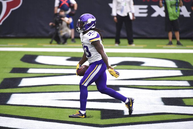 Minnesota Vikings running back Dalvin Cook (33) scores a touchdown against the Houston Texans during first half of an NFL football game Sunday, Oct. 4, 2020, in Houston. (AP Photo/Eric Christian Smith)