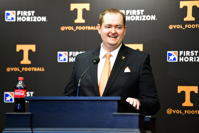FILE — In this Jan. 27, 2021, file photo, Tennessee's new football coach, Josh Heupel, speaks during an introductory news conference in Knoxville, Tenn. The new operating speed for the Tennessee Volunteers is fast. Not as speedy as Heupel wants once the season starts, but pretty quick for April. Offensive linemen like Heupel's new offense because they're snapping the ball and lining back up again so fast they can see defensive linemen wearing down during drives. (Caitie McLekin/Knoxville News Sentinel via AP, Pool)
