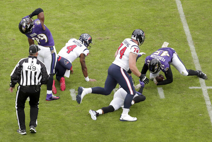 Baltimore Ravens linebacker Jaylon Ferguson (45) collects a fumble by Houston Texans quarterback Deshaun Watson (4) on a sack by Ravens outside linebacker Matt Judon (99) during the first half of an NFL football game, Sunday, Nov. 17, 2019, in Baltimore. (AP Photo/Julio Cortez)