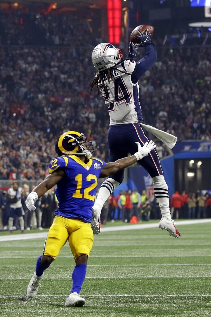 New England Patriots' Stephon Gilmore (24) intercepts a pass intended for Los Angeles Rams' Brandin Cooks (12), during the second half of the NFL Super Bowl 53 football game Sunday, Feb. 3, 2019, in Atlanta. (AP Photo/Frank Franklin II)