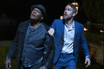 """This image released by Lionsgate shows Ryan Reynolds, right, and Samuel L. Jackson in a scene from """"The Hitman's Wife's Bodyguard."""" (David Appleby/Lionsgate via AP)"""
