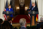 FILE - In this file photo from April 27, 2018, President Donald Trump speaks during a news conference with German Chancellor Angela Merkel in the East Room of the White House in Washington. Trump said in Brussels on Wednesday, July 11, 2018, that a pipeline project has made Germany