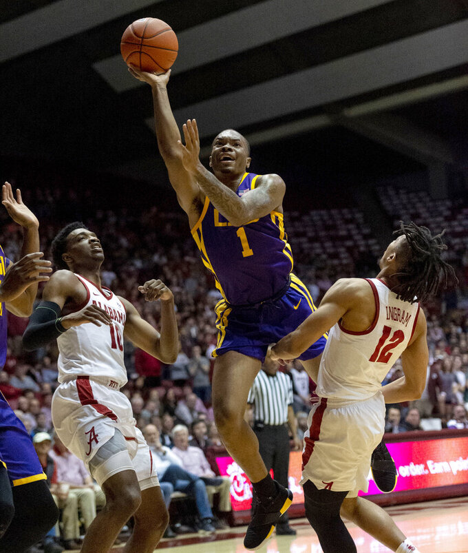 LSU guard Javonte Smart (1) gets between Alabama guards Herbert Jones (10) and Dazon Ingram (12) for a shot during the first half of an NCAA college basketball game, Saturday, March 2, 2019, in Tuscaloosa, Ala. (AP Photo/Vasha Hunt)