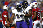Baltimore Ravens cornerback Brandon Carr (24) celebrates with teammate Tyus Bowser after sacking Arizona Cardinals quarterback Kyler Murray in the second half of an NFL football game, Sunday, Sept. 15, 2019, in Baltimore. (AP Photo/Nick Wass)
