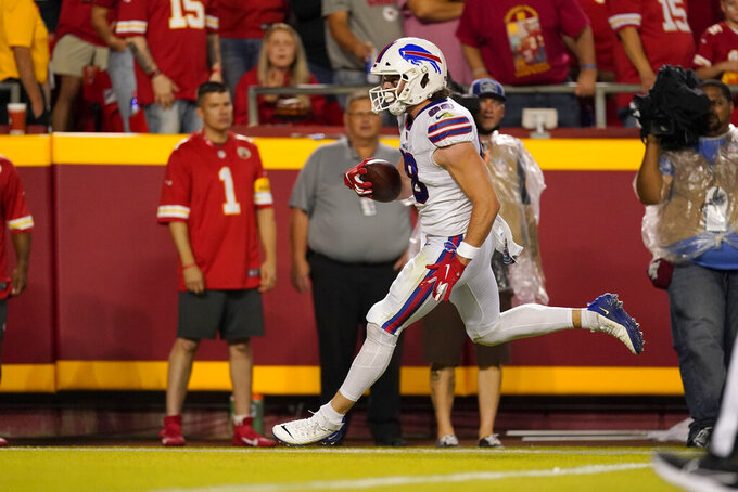 Buffalo Bills tight end Dawson Knox scores during the first half of an NFL football game against the Kansas City Chiefs Sunday, Oct. 10, 2021, in Kansas City, Mo. (AP Photo/Charlie Riedel)