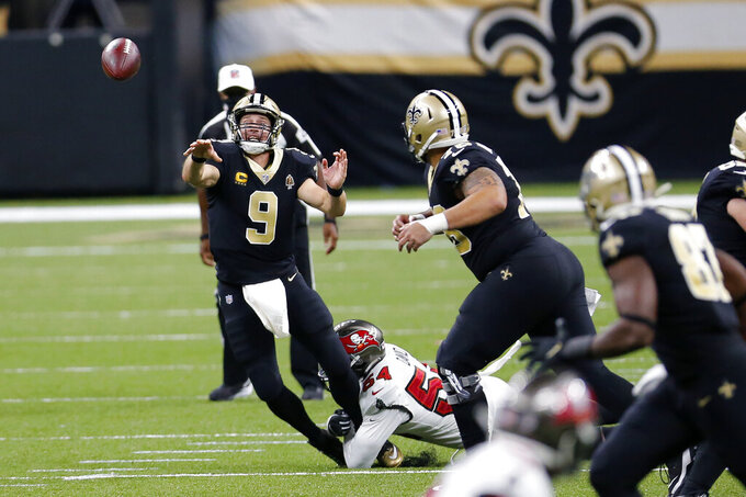 New Orleans Saints quarterback Drew Brees (9) passes under pressure from Tampa Bay Buccaneers outside linebacker Lavonte David (54) in the second half of an NFL football game in New Orleans, Sunday, Sept. 13, 2020. (AP Photo/Brett Duke)