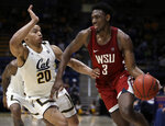 Washington State's Robert Franks, right, drives the ball against California's Matt Bradley (20) in the second half of an NCAA college basketball game Saturday, March 2, 2019, in Berkeley, Calif. (AP Photo/Ben Margot)