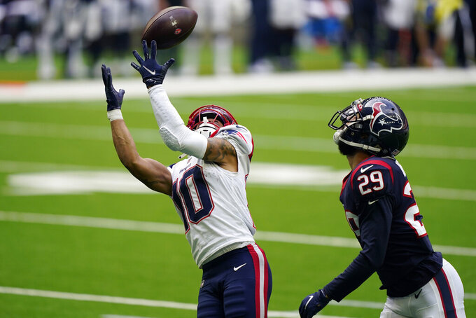 New England Patriots wide receiver Damiere Byrd (10) catches a pass for a touchdown past Houston Texans cornerback Phillip Gaines (29) during the second half of an NFL football game, Sunday, Nov. 22, 2020, in Houston. (AP Photo/David J. Phillip)